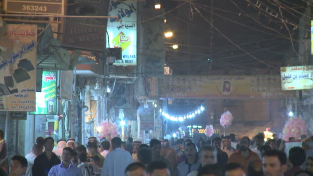 august 26, 2010 crowds of festival goers walking through streets at the close of ramadan / najaf, iraq - najaf stock videos & royalty-free footage