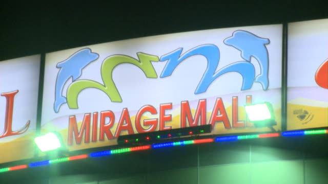 august 26 2010 montage exterior mirage mall signs and neon lights / najaf iraq - najaf stock-videos und b-roll-filmmaterial