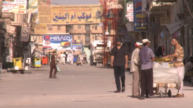 stockvideo's en b-roll-footage met august 26 2010 ms shoppers and vendors in an outdoor market / najaf iraq - najaf