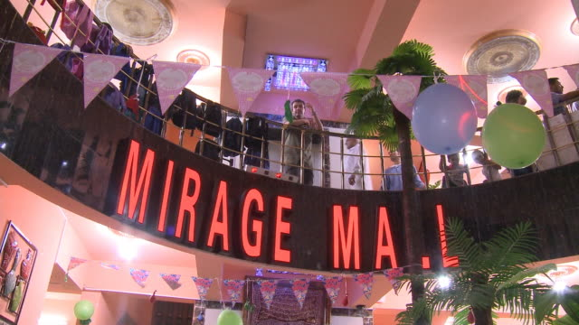august 26, 2010 shoppers in the mirage mall, with the sign hanging around a second floor balcony / najaf, iraq - najaf stock videos & royalty-free footage