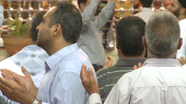 august 26 2010 ms worshipers praying in front of imam ali mosque at close of ramadan / najaf iraq - shrine of the imam ali ibn abi talib stock videos & royalty-free footage