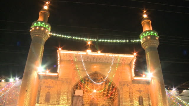 august 26, 2010 worshipers standing in front of imam ali mosque at close of ramadan / najaf, iraq - shrine of the imam ali ibn abi talib stock videos & royalty-free footage