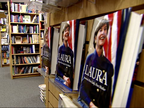 august 27 2002 cu biography of laura bush on a shelf at a borders bookstore / united states - biography stock videos & royalty-free footage