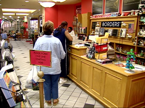 vídeos y material grabado en eventos de stock de august 27, 2002 montage shoppers buying books at a borders bookstore / united states - borders books