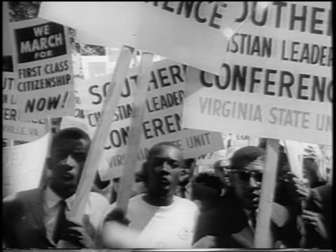august 28, 1963 crowd marching with sclc signs towards camera / march on washington / newsreel - 1963 stock videos & royalty-free footage