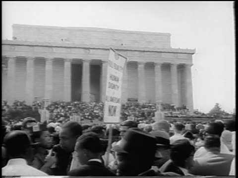 b/w august 28 1963 crowd with signs in front of lincoln memorial / march on washington / newsreel - 1963 march on washington stock videos and b-roll footage