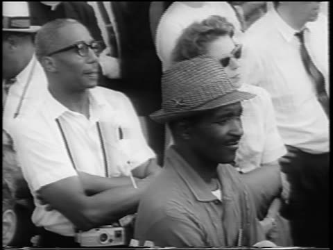 b/w august 28 1963 high angle black men caucasian woman watching speech / march on washington / newsreel - 1963 march on washington stock videos and b-roll footage