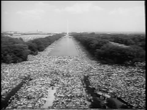 b/w august 28 1963 high angle wide shot huge crowd in mall / march on washington / newsreel - 1963 march on washington stock videos and b-roll footage