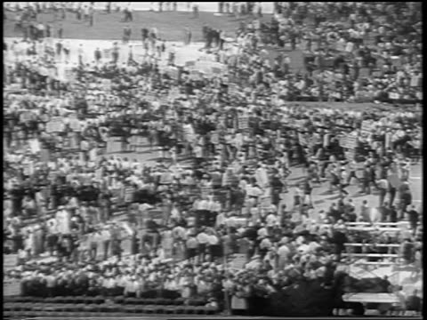 b/w august 28 1963 high angle zoom out crowd with signs in mall / march on washington / newsreel - black civil rights stock videos & royalty-free footage
