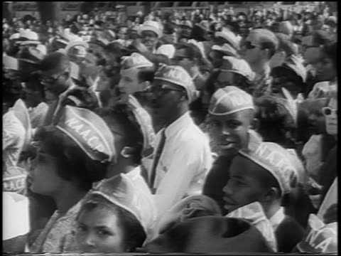 august 28, 1963 interracial crowd with naacp hats watching speech / march on washington / newsreel - 1963 stock videos & royalty-free footage