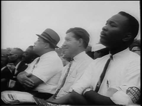 august 28, 1963 low angle 3 black + white men sit watching speech / march on washington / newsreel - 1963 stock videos & royalty-free footage