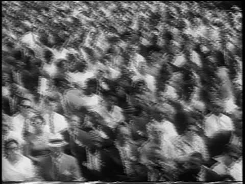 b/w august 28 1963 tilt up pan huge crowd in mall at march on washington / newsreel - 1963 march on washington stock videos and b-roll footage