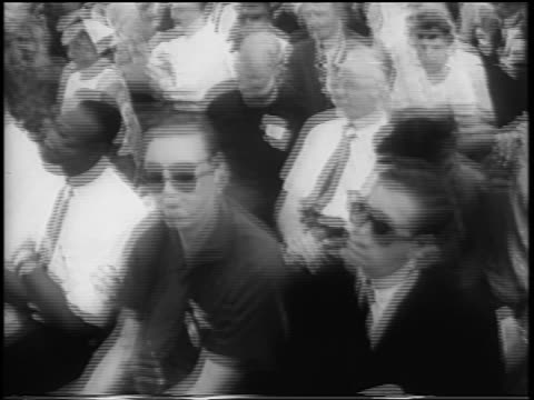 b/w august 28 1963 tilt up interracial crowd sit watching speech / march on washington / newsreel - 1963 march on washington stock videos and b-roll footage