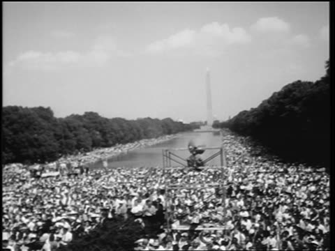 b/w august 28 1963 wide shot huge crowd cheering at march on washington / washington monument in background - black civil rights stock videos & royalty-free footage