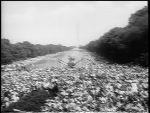 B/W August 28 1963 wide shot PAN huge crowd clapping in Mall at March on Washington / newsreel