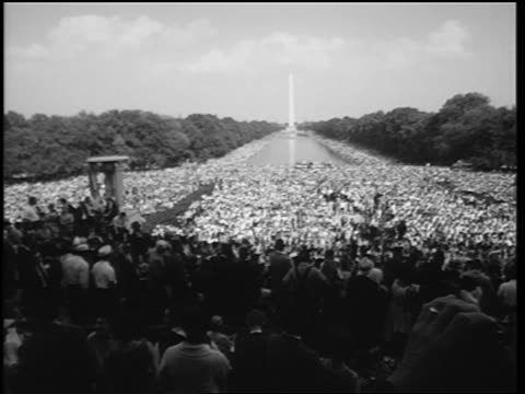 august 28, 1963 wide shot huge crowd in mall at march on washington / washington monument in background - 1963 stock videos & royalty-free footage