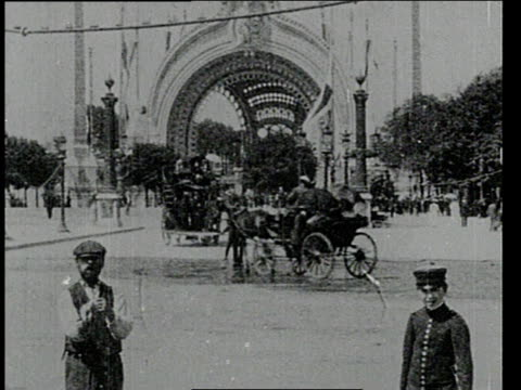 August 29, 1900 WS Horse-drawn carriages and people proceeding through busy intersection / Paris, France