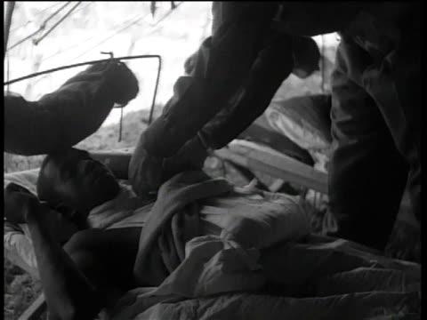august 29, 1944 general mark clark decorating injured soldier at 56th evacuation hospital / peccioli, italy - 死傷者点の映像素材/bロール