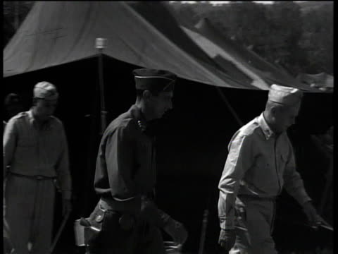 august 29, 1944 general mark clark walking through camp at 56th evacuation hospital / peccioli, italy - 死傷者点の映像素材/bロール