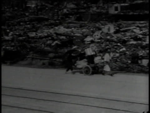august 30 1945 montage japanese people carrying belongings and picking through rubble / tokyo japan - ruined stock videos & royalty-free footage
