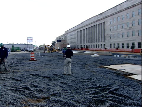 august 30, 2002 panorama of construction workers outside pentagon / arlington, virginia, united states - the pentagon stock videos & royalty-free footage