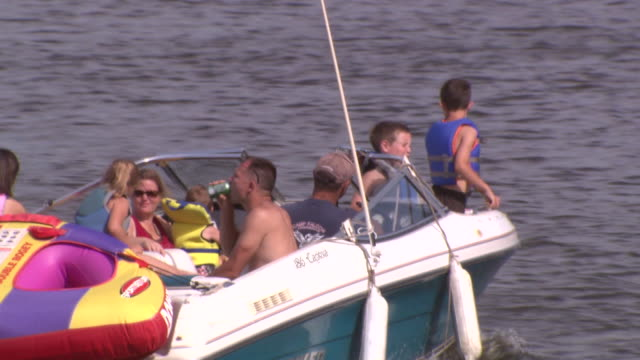August 31 2008 TS Motorboat full of family members on river / St Paul Minnesota United States