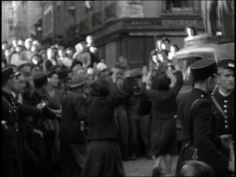august 4 1944 montage civilians kicking and taunting collaborators being placed under arrest / rennes france - rennes frankreich stock-videos und b-roll-filmmaterial