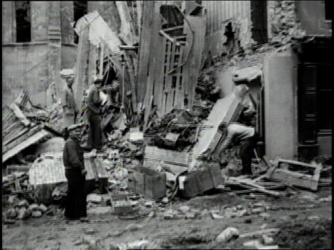 august 4 1944 montage civilians sifting through damaged building in a french town during wwii / rennes france - rennes frankreich stock-videos und b-roll-filmmaterial