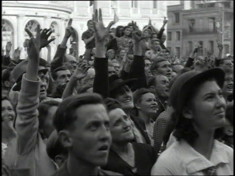 august 4, 1944 montage crowd listening to french and american leaders speak from a balcony / rennes, france - allied forces stock videos & royalty-free footage