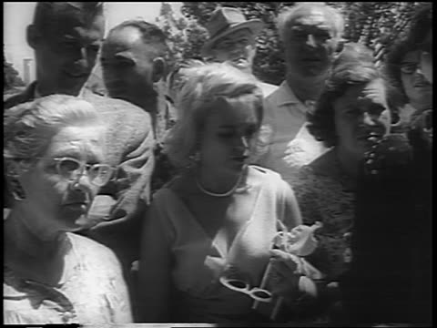 B/W August 8 1962 group of people mourning at Marilyn Monroe's funeral / Los Angeles / newsreel