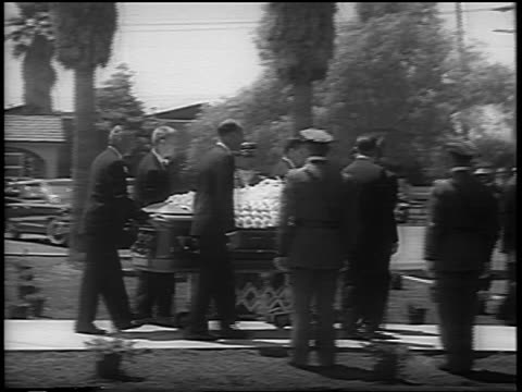august 8, 1962 pallbearers wheeling coffin of marilyn monroe on sidewalk outdoors / los angeles - 1962 stock videos & royalty-free footage