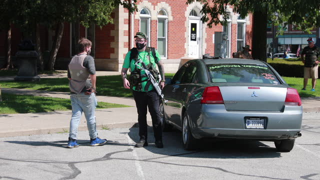 august 8, 2020; martinsville, indiana: blm protesters retrieve a rifle from a car as black lives matter activists hold a rally on the morgan county... - weapon stock videos & royalty-free footage