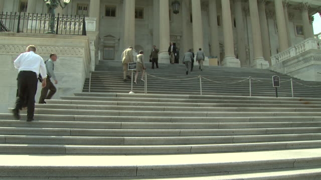 august 9 2006 ts congress members walking up the steps into the capitol / washington dc united states - united states congress stock videos & royalty-free footage