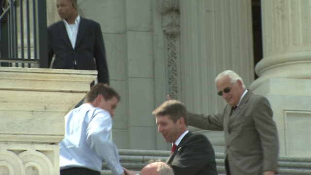 vídeos de stock e filmes b-roll de august 9 2006 ts justice john paul stevens greeting people in passing on the steps of the us supreme court building / washington dc united states - john paul stevens