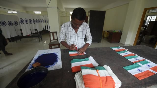 august. employee of assam khadi and village industries board prints ashoka chakra on the tricolor or indian flag as part of preparations ahead of... - printing out stock videos & royalty-free footage