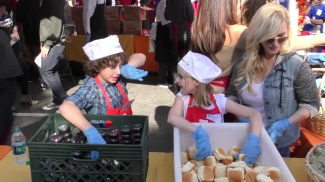 august maturo and mckenna grace serving thanksgiving dinner to the homeless at the los angeles mission at celebrity sightings in los angeles on... - maturo stock videos & royalty-free footage