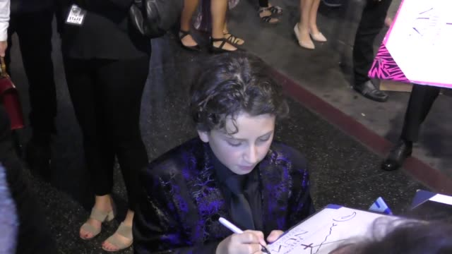 august maturo signs for fans outside the nun premiere at tcl chinese theatre in hollywood in celebrity sightings in los angeles - maturo stock videos & royalty-free footage