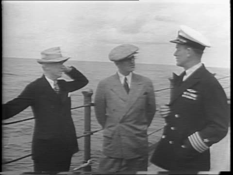 uss augusta at sea trailed by three ships / president harry truman secretary of state james f byrnes and ship's captain james hicks foskett stand at... - potsdam conference stock videos and b-roll footage