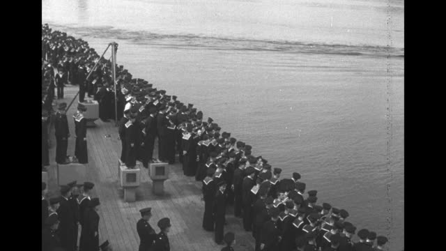 "augusta carrying us pres. franklin roosevelt pulling away from hms prince of wales, sailors and officers on ""prince of wales"" watching / ""augusta""... - marinaio video stock e b–roll"