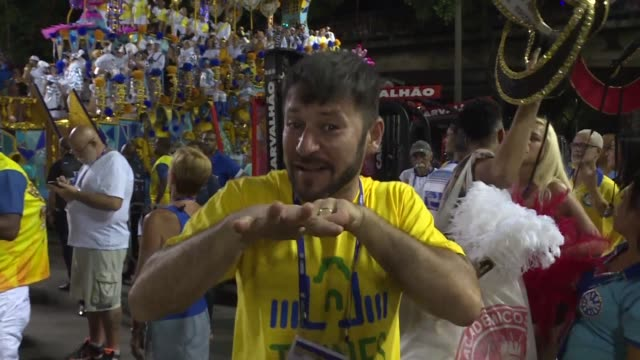aulio nobrega who couldn't hear a thing when hundreds of drummers marched into rio de janeiro's sambodromo on monday still has to cover the carnival... - brazilian carnival stock videos and b-roll footage