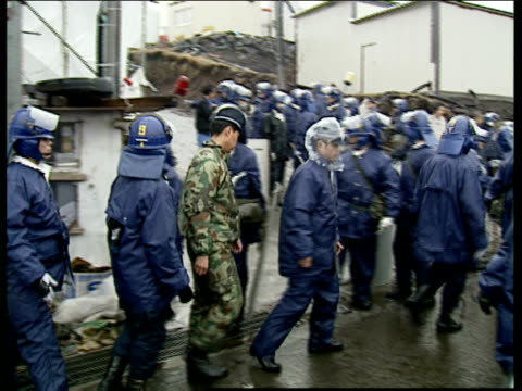 aum shinrikyo cult members and police at satian 7 japan kamikuishiki satian 7 ext group of police officers along / various shots of aum shinrikyo... - cult stock videos & royalty-free footage