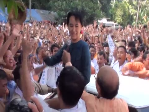 Aung San Suu Kyi greets crowds of supporters on her second day of release
