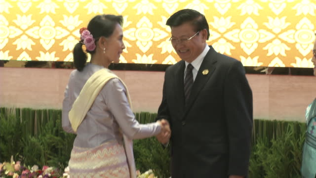 aung san suu kyi is greeted by the laos prime minister thongloun sisoulith and wife at the association of southeast asian nations summit the laotian... - association of southeast asian nations stock videos & royalty-free footage