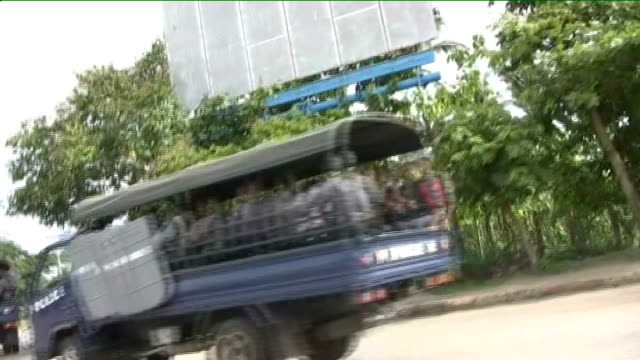 Aung San Suu Kyi stands trial for breaching house arrest terms BURMA Rangoon Insein prison EXT Police trucks along road line of police trucks...