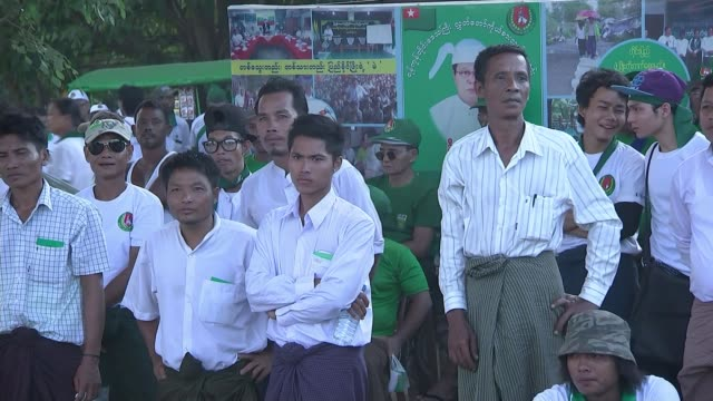 aung san suu kyi victory predicted / challenge in her constituency various of people attending rally - politische gruppe stock-videos und b-roll-filmmaterial