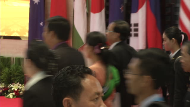 aung san suu kyi walks to a meeting during the association of southeast asian nations summit the laotian capital vientiane - association of southeast asian nations stock videos & royalty-free footage