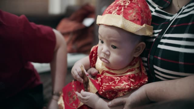 aunt giving family lucky red envelopes for chinese new year - aunt stock videos & royalty-free footage