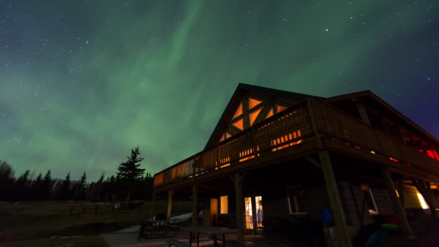 aurora above a lodge shelter in alaska - log cabin stock videos & royalty-free footage