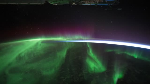 / aurora australis over the indian ocean as seen from the international space station. aurora australis over the indian ocean on march 04, 2012 in in... - aurora australis stock videos & royalty-free footage
