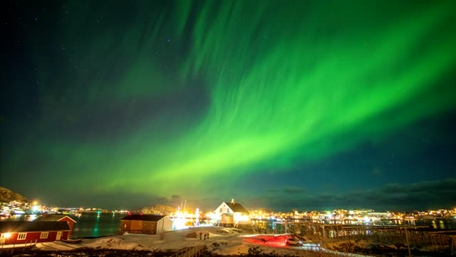 aurora borealis (northern lights) above fishing village in arctic ocean - northern europe stock videos & royalty-free footage